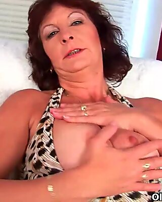 Granny with big udders finger plumbs her hairy cooch