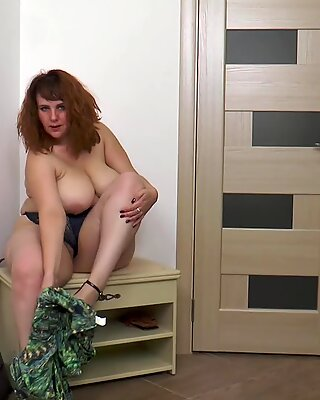Hairy pussy being played by a curvy red head