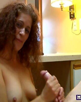 Cocktugging redheaded milf wanks cock