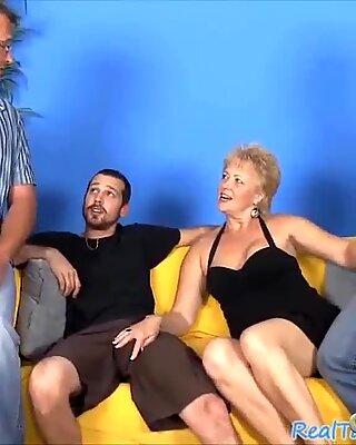 light-haired grandma deep-throating three hard dicks