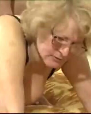 A light-haired gran with glasses rides her super hot young stud
